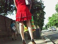 Cute brunette in red dress upskirt