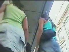 Upskirt action in the public place with tanned young chick