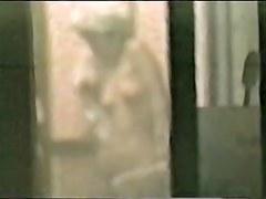 Blonde neighbor dressing on voyeured through the window