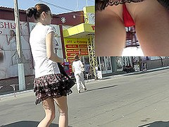 Public upskirt view presents charming red panties