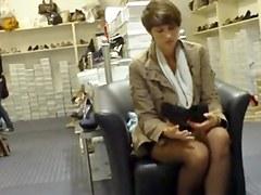 candid black nylon feet in shoe store