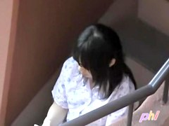 Texting on stairs has earned herself a boob sharking place