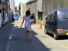 Brown haired Asian beauty skirt sharked on the street