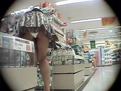 Amazing upskirt video of very hot long-legged seductive bimbo