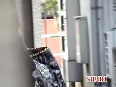 Outdoor sharking scene of cute oriental bitch being really surprised