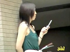 Black-haired pretty babe messing with her phone during wild top sharking