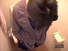 Cute Japanese girl nude masturbation in the toilet