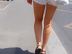 beautifull legs walking in the street in mini shorts