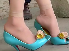 Candid Asian Shoeplay in blue high heels and nylons