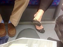 Candid mature dangling shoeplay feet
