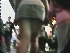 Upskirt view of long legged milf walking with her friend