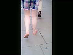 Candid girl's naked feet