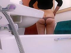 Big ass wife caught by hidden camera pissing