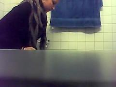 Blonde Peeing in Bathroom