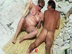 Chubby mature nudist woman at beach