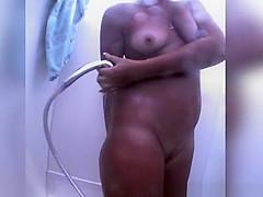 Woman spied in beach cabin washing body