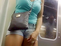 Busty chick down blouse and cleavage in metro