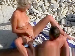 Mature Couple Playing on Beach