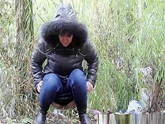 Woman peeing in the nature