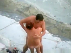 Mature couple blowjob in seashore