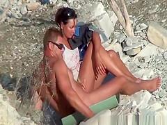Wife strokes his man dick in beach