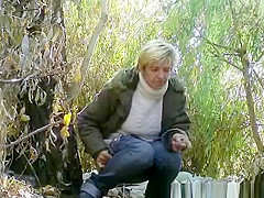 Mature pissing and smoking outdoors