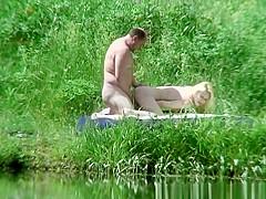 Fat dude fucks blonde in river bank