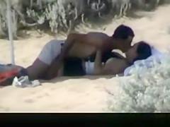 Couple spied in the beach fucking under the sun umbrella