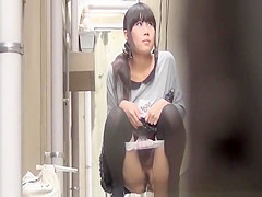 Japanese women pissing beyond a building