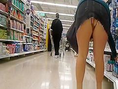 Exhibitionist woman wearing crotchless panties