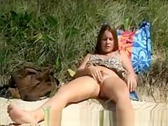 Hairy chick masturbating in beach