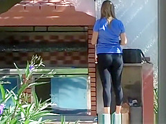 Woman in tight sports pants and tight blue top
