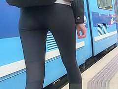 Girl wearing black leggings nice butt