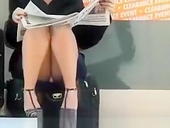 Upskirting hot blonde milf at the airport