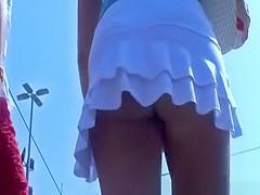Girl in short white skirt ass upskirted