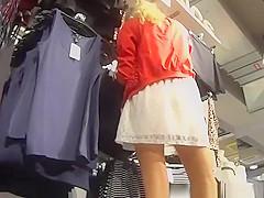 Sexy blonde in white mini skirt upskirt