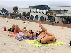 Fit blonde exercises on beach