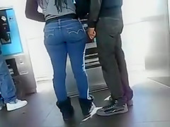 Girl with a big butt waits in a line