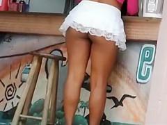 Upskirt of mulatto street prostitute