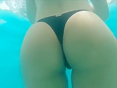 Asses from inside swimming pool