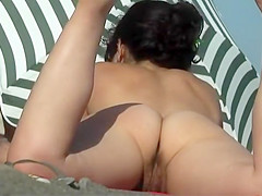 Naked milf in the beach shower cabin