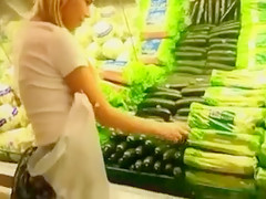 Daring Blonde Girl Masturbates with Cucumber in Public Shop
