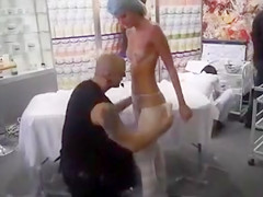 Topless sunburned girl wrapped to relieve her pain