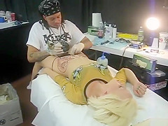 Blonde bimbo moans with pain as her pubis was being tattooed