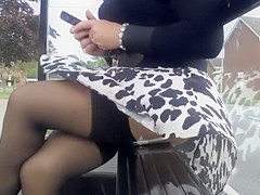 Smoking hot lady in a leopard skirt has her undies revealed