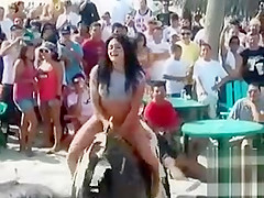 Chubby hoochie rides an electronic bull in her G-strings