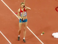 Pole vaulter with a nice butt competes in an event