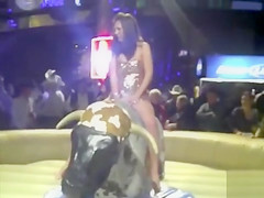 Hottie rides the bull while everyone sees her undies