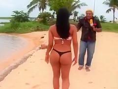 Smoking hot Brazilian sex bomb poses on the sandbeach