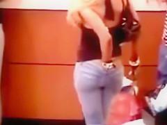 Surveillance camera films a girl scratching her ass